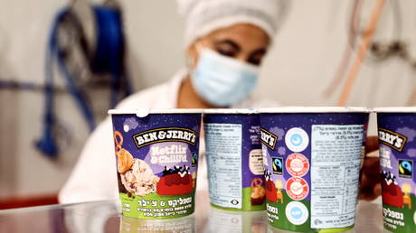 Tubs of ice-cream are seen as a labourer works at Ben & Jerry's factory in Be'er Tuvia, Israel