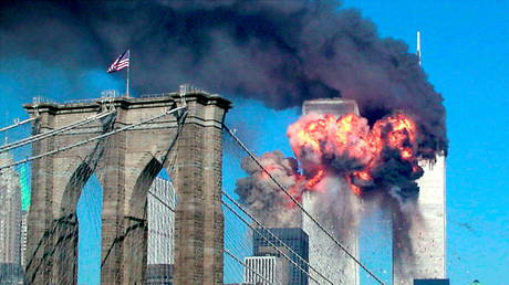 FILE PHOTO: The second tower of the World Trade Center bursts into flames after being hit by a hijacked airplane in New York, US, September 11, 2001. © REUTERS/Sara K. Schwittek