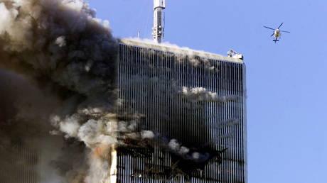 FILE PHOTO: The World Trade Center in New York City burns in New York, US, early September 11, 2001. © REUTERS/Jeff Christensen