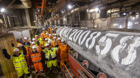 """Workers onboard Russia's pipe-laying ship """"Fortuna"""" celebrate as they prepare to lay the final section of Nord Stream 2, in Germany. The Fortuna crew welded the final part, number 200,858, on Friday."""