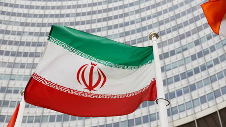 The Iranian flag waves in front of the International Atomic Energy Agency (IAEA) headquarters, in Vienna
