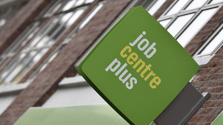 A Job Centre Plus sign is seen in central London, Britain (FILE PHOTO) © REUTERS/Toby Melville