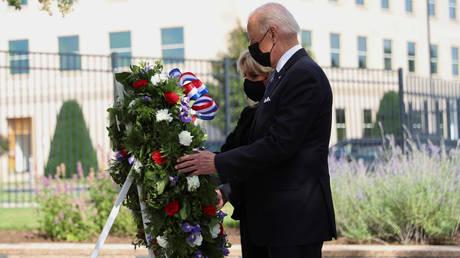 U.S. President Joe Biden and first lady Jill Biden lay a wreath at the Pentagon on the 20th anniversary of the September 11, 2001 attacks in Arlington, Virginia, U.S., September 11, 2021. © Reuters / Tom Brenner