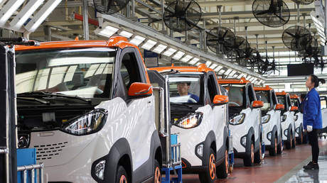 China sets out to reign in country's bloated EV industry