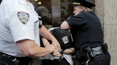 , Chokeholds and 'no-knock' police entries banned under new DOJ policy in bid to build public 'trust',
