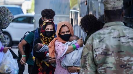 FILE PHOTO: Afghan refugees arrive at Dulles International Airport in Virginia, September 2, 2021.