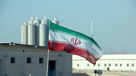 A picture taken on November 10, 2019, shows an Iranian flag in Iran's Bushehr nuclear power plant. © AFP / Atta Kenare