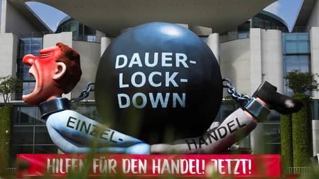FILE PHOTO: A paper-mache figure reading 'Help for the commerce now' during a protest against Covid-19 lockdowns in Berlin, Germany, May 19, 2021