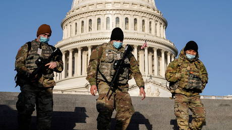 Members of the National Guard patrol at the US Capitol in Washington DC, March 4, 2021 © Reuters / Joshua Roberts