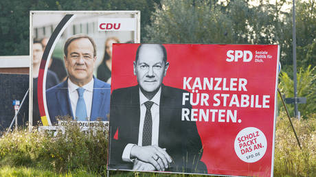 Election poster of the SPD with Olaf Scholz in front of the CDU with Armin Laschet on an embankment during the election campaign of the parties for the 2021 bundestag election on September 10, 2021 in Dortmund, Germany. © Alex Gottschalk/DeFodi Images via Getty Images
