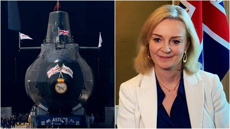 THe HMS Astute nuclear-powered submarine is launched at the Devonshire Dock Hall in Barrow-in-Furness, northwest England. © Reuters / Kieran Doherty; British Foreign Secretary Liz Truss © Reuters / Pedja Stanisic