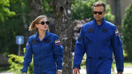 Actress Yulia Peresild and filmmaker Klim Shipenko walk during a training for the upcoming space mission to the International Space Station (ISS) at the Cosmonaut Training Centre in Star City, Moscow region, Russia. © Sputnik / Kirill Kallinikov