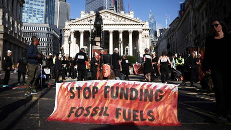 FILE PHOTO. Extinction Rebellion climate activists protest outside the Bank of England in London, Britain. © Reuters / Henry Nicholls