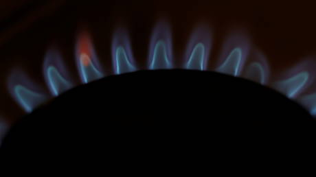 Flames come out of a domestic gas ring on a stove in Manchester, Britain on September 20, 2021.
