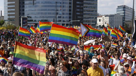 People demonstrate and march with Gay Pride flags during the Warsaw Gay Pride parade in central Warsaw on June 19, 2021. © AFP / Wojtek Radwanski