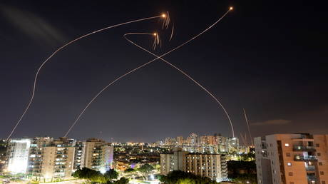 Streaks of light are seen as Israel's Iron Dome anti-missile system intercept rockets launched from the Gaza Strip towards Israel on May 13, 2021.