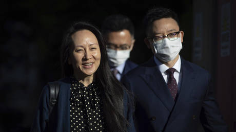 Chief financial officer of Huawei Meng Wanzhou leaves her home in Vancouver on September 24, 2021.