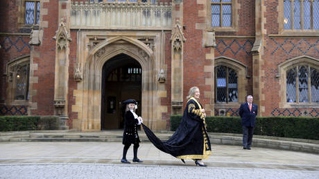 Former US Secretary of State Hillary Clinton after being inaugurated as the first female chancellor of Queens University in Belfast, Northern Ireland, September 24, 2021.