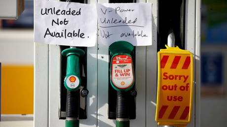 Hand written signs are stuck to a petrol pump with no fuel available at a Shell filling station in Manchester, Britain on September 24, 2021.