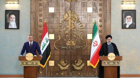 FILE PHOTO: Iraqi Prime Minister Mustafa Al-Kadhimi and Iranian President Ebrahim Raisi