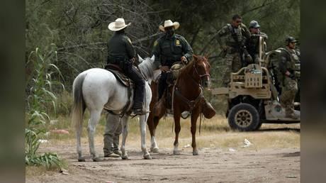 US Border Patrol officers are shown last week, standing guard near the International Bridge in Del Rio, Texas.