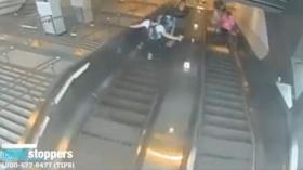WATCH: Man viciously KICKS woman down NYC subway escalator, sending her plummeting backwards