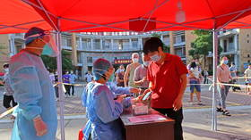 China's Covid-19 cases soar ahead of week-long national holiday, some infections are vaccine-busting Delta