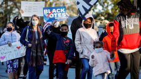 Court blocks North Carolina voter ID law, says it discriminates against black people