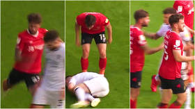 'Got what he deserved': Fans split after footballer is viciously kicked by opponent... only to be booked by ref in England (VIDEO)