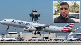 'Not all terrorists': Boxer Khan furious at 'disgusting' American Airlines after being booted off flight in 'face mask row'