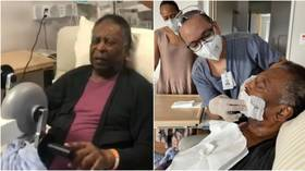 Pele pedals on EXERCISE BIKE in hospital bed as 80-year-old icon attempts to reassure fans he's fine after health scare (VIDEO)
