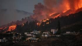 Volcanic eruption forces 5,000 people to flee La Palma villages as lava flow destroys homes