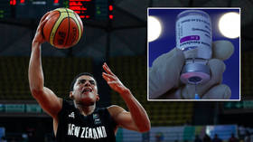 'I completely double down': Basketball star axed for rejecting vaccine... a month after his brother was released over Pfizer claim
