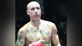 Italian boxer with Nazi & white supremacist tattoos causes outrage after fight is livestreamed by major sports outlet