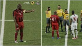 60-year-old Suriname vice-president names himself captain for crunch cup clash before 'dishing out money in changing room' (VIDEO)