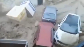 Cars dragged through Spanish streets after heavy rainfall causes flash floods (VIDEOS)