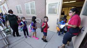 Washington elementary school walks back 'insane' rule asking students to wear masks WHILE EATING