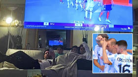 'Let's go!': Lionel Messi celebrates with his family in their lounge after watching Argentina knock Russia out of futsal World Cup