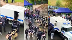 Russian National Football League launches investigation after barred fans clash with police outside stadium before match (VIDEO)