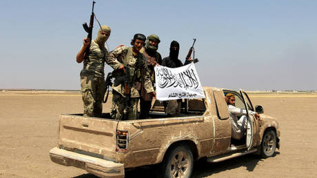 FILE PHOTO: Fighters of the jihadist group Jabhat Fateh al-Sham – which later joined other Islamist cells to form the Hay'at Tahrir al-Sham umbrella group – are seen in the rebel-held Idlib province, Syria.