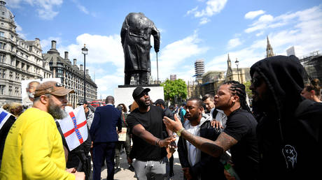 FILE PHOTO: Demonstrators argue during a Black Lives Matter protest by the Winston Churchill statue in Westminster, London, June 9, 2020 ©  Reuters / Toby Melville