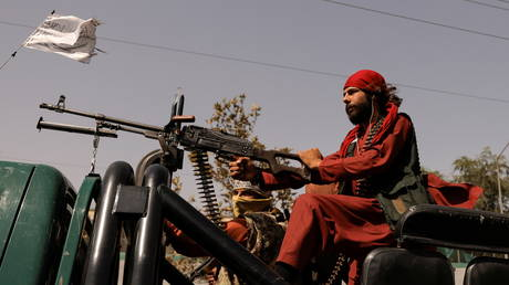 Members of Taliban forces ride on a pick-up truck mounted with a weapon in Kabul, Afghanistan on October 3, 2021.