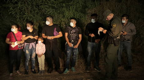 Migrants are lined up and processed by US Border Patrol in Roma, Texas
