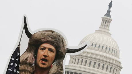 FILE PHOTO: An art installation protest by the organization SumOfUs portrays Facebook CEO Mark Zuckerberg as a January 6th rioter near the US Capitol in Washington, US, March 25, 2021.