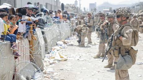 US Marines provide assistance during evacuation at Hamid Karzai International Airport, in Kabul, Afghanistan
