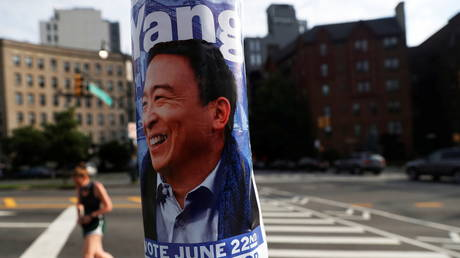 Signs for Democratic candidate for New York City Mayor Andrew Yang hang on a light pole outside the Brooklyn Museum voting station in New York