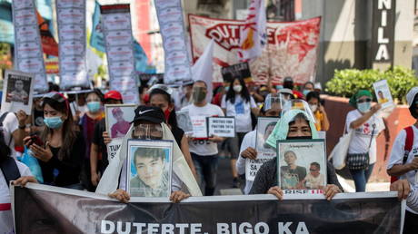 FILE PHOTO: Relatives of drug war victims march towards the presidential Malacanang Palace in Manila, Philippines, on June 30, 2021.