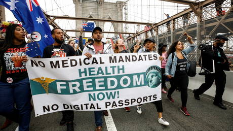 Protesters demonstrate against vaccine mandates for teachers and school staff on the Brooklyn Bridge, in New York City, October 4, 2021.
