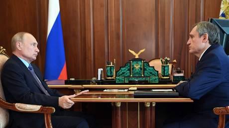 FILE PHOTO: Russian President Vladimir Putin (L) meets Energy Minister Nikolay Shulginov (R).