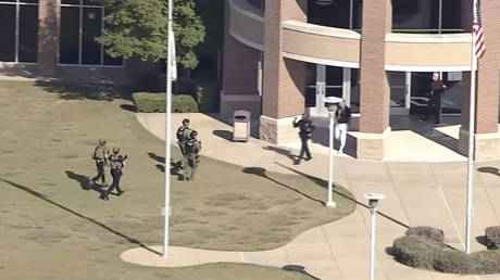 Law enforcement arrives at Timberview High School on Wednesday, Oct. 6, 2021 in Arlington, Texas. ©WFAA-TV via AP
